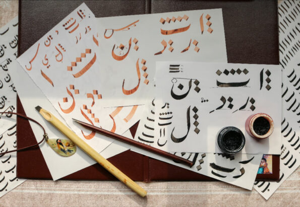 white-papers-on-table-with-written-calligraphy-art-3139298_pizap