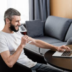 man_wine_laptop_pizap